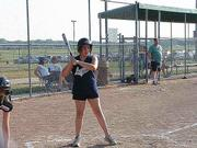 Emma Kloster gets the signal from her coach to swing away in the top of the third inning.  The Smurfs needed all the offense they could get, but went on to lose to the Black Beauties 21-8, on June 22 at Youth Sports Inc.