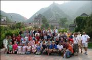 Members of the Kansas University Wind Ensemble visiting China are shown at the Great Wall. Director John Lynch is shown fourth from the right in the back row, wearing sun glasses. Nine additional KU faculty members accompanied the 59-member band.