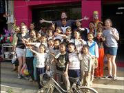 Members of the KU Wind Ensemble take a snapshot with a group of children in China. The band spent 12 days in late May and early June giving performances and master classes in the country.