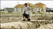 Shane James works on the plumbing system in a house being built in Port St. Lucie, Fla., on Wednesday. In the last few years, businesses and housing developments around the Port St. Lucie Area have multiplied and spilled farther west. Port St. Lucie is the fastest-growing large city in the nation, according to census figures for 2003-2004 to be released today.