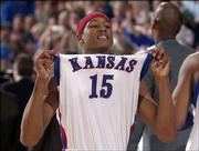 J.R. Giddens holds his head and jersey high following a 90-89 overtime victory against Iowa State on Feb. 21, 2004 at Allen Fieldhouse. The Jayhawks announced Thursday that Giddens was leaving the program and transferring to another school.
