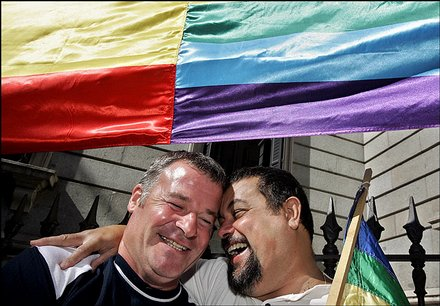 Supporters of gay marriage celebrate under the gay flag outside the Spanish ...