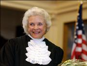 U.S. Supreme Court Justice Sandra Day O'Connor is shown before administering the oath of office to members of the Texas Supreme Court on Jan. 6, 2003, in Austin, Texas. O'Connor, the first woman on the Supreme Court and a swing vote on abortion, as well as other contentious issues, announced her retirement Friday.