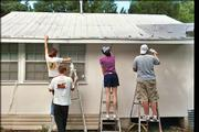 Members of the senior youth Group at Plymouth Congregational Church, 925 Vt., paint a house in Biloxi, Miss. The group ventured there recently to help provide shelter and comfort for less fortunate members of the community through the Back Bay Mission.