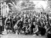 Members of the Kansas University volleyball squad pose with Brazilians in Rio de Janeiro. The Jayhawks traveled to Brazil this spring after final exams.
