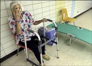 Annie Chaisson, 86, of Isle de Jean Charles, La., rests after she and her son, Hilton Chaisson, arrived at an American Red Cross storm relief shelter Tuesday at South Terrebonne High School in Bourg, La., as Tropical Storm Cindy hit the Gulf coast.