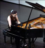 Yi-ju Lai, Yuanlin, Taiwan, plays in the final competition of the 2005 International Piano Competition, which was part of the International Institute for Young Musicians. Finals were Tuesday at Kansas University's Lied Center.