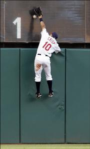 Cleveland Indians outfielder coco crisp jumps on the wall but cannot get a ball hit by Detroit's Magglio Ordonez. The play resulted in a two-run double, and the Tigers went on the beat the Indians, 7-3, Wednesday in Cleveland.