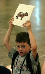 John Peterson, 6, plays a game of name the animals as part of the Communication Camp Thursday.