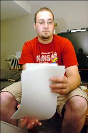 Geoff Griffith, a 20-year-old Lawrence resident, has lost $2,000 in a popular e-mail scam. The Johnson County Community College student had to dip into his tuition money to compensate for the loss.