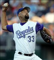Kansas City starting pitcher Jose Lima pitches to Minnesota's Shannon Stewart. Lima earned just his second victory of the season, and the Royals won, 8-5, Thursday in Kansas City, Mo.