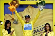 Overall leader and six-time champion Lance Armstrong waves from the podium after the sixth stage of the Tour de France.