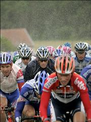 Armstrong, of Austin, Texas, center, rides in the pack during Thursday's stage between Troyes and Nancy in eastern France.