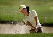 Michelle Wie hits out of a bunker on the second hole. Wie shot a 1-under 70 Thursday in the John Deere Classic at Silvis, Ill.