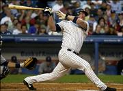 New York's Jason Giambi follows through on a home run against Cleveland. The Yankees defeated the Indians, 7-2, Thursday night in New York.