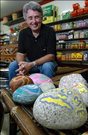 Loring Henderson, executive director of the Lawrence Community Shelter, is helping the homeless find ways to make money. These rocks are being sold at the Clinton Parkway Nursery, 4900 Clinton Parkway, with proceeds going to the shelter.