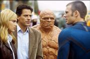 "Sue (Jessica Alba), left, Reed (Ioan Gruffudd), Ben (Michael Chiklis) and Johnny (Chris Evans) react to their newfound powers in ""The Fantastic Four."""