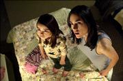 "Ariel Gade, left, and Jennifer Connelly discover a creepy apartment in ""Dark Water."""