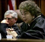 Chief Justice Kay McFarland and the Kansas Supreme Court decided Friday that the lawmakers had met a court-ordered mandate to increase funding for public education.