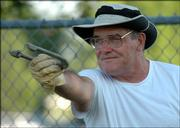 Ken Perry, of Basehor, lines up his pitch during league play with the Lawrence Horseshoe Club at Broken Arrow Park.