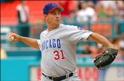 Chicago Cubs pitcher Greg Maddux delivers against Florida. Maddux threw eight shutout innings in the Cubs' 9-2 victory Sunday in Miami.