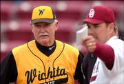 Wichita State baseball coach Gene Stephenson, left, talks to Oklahoma interim coach Sunny Galloway before their teams' game May 3 in Norman, Okla. After 28 seasons at WSU, Stephenson, a former OU assistant, is leaving to become head coach of the Sooners.
