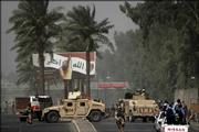 "Under an Iraqi election billboard, U.S. troops, Iraqi police and Iraqi military arrive on the scene of a suicide bombing Sunday outside an Iraqi army recruiting center in Baghdad, Iraq. The billboard reads: ""God Is Great. We swear by the blood in our veins and the ink on our finger that we will not be defeated."""