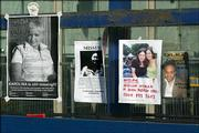 Posters of people who are still missing following Thursday's bomb attacks in London hang Sunday outside King's Cross Train Station in the British capital. Many people have taken to the streets of London, visiting sites to pay their respects to the dead and injured after the bomb attacks.