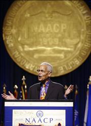 Julian Bond, chairman of the board of the National Association for the Advancement of Colored People, speaks Sunday at the Opening of the NAACP 96th annual convention at the Midwest Airlines Center in Milwaukee.