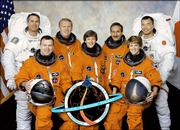 In this image released by NASA, STS-114 astronauts pose for their group photo.