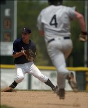 Lawrence Outlaws second baseman Matt Birtmer grabs the ball as Chanute's Blane Audiss runs toward the base. The Outlaws lost the first game of their doubleheader Sunday at Free State High, 6-0, but rebounded to win the nightcap, 12-9.