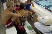 Alex Brunfeldt, left, sits with his teammates during the Roger Hill Invitational swim meet. Brunfeldt, a Free State High product who now swims for Indiana University, won four events Sunday at the Lawrence Indoor Aquatic Center.