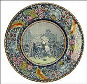 The Boston Massacre of 1770 is pictured on this blue transfer plate. The border has been colored. It was made in the early 1900s; it's a reproduction of a much earlier plate.