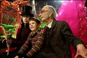 "Johnny Depp, left, Freddie Highmore and David Kelly explore the reclusive inventor&squot;s facility in ""Charlie and the Chocolate Factory."""