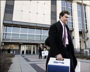 Former Westar Energy Inc. executive David Wittig leaves the federal courthouse Dec. 20 in Kansas City, Kan. Wittig's first federal fraud trial ended in a mistrial after jurors could not reach a verdict on more than half the charges. Wittig's second trial is under way.