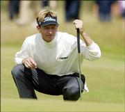 Brad Faxon lines up a putt on the 16th green. Faxon, who flew to Scotland to qualify for the British Open, shot 6-under 66 Friday in St. Andrews, Scotland and is tied for third place.