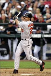 Baltimore's Rafael Palmeiro rips the 3,000th hit of his career, a double off Seattle' Joel Pineiro. Palmeiro reached the milestone Friday night in Seattle.