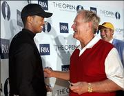 Jack Nicklaus, right, greets fellow American Tiger Woods after a news conference. Nicklaus played his final round in a major Friday at the British Open in St. Andrews, Scotland. Woods leads at 11-under par heading into today's third round.