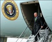 Chief presidential adviser Karl Rove walks down the stairs of Air Force One on Friday at Andrews Air Force Base in Washington.
