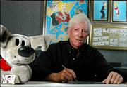 "Dean Young, writer of the ""Blondie"" comic strip, works in his studio in Clearwater, Fla. Young, who took over the strip from his father, Chic Young, in 1973, is celebrating the 75th anniversary with a three-month story line featuring cameos from fellow comic strip favorites and other surprises."