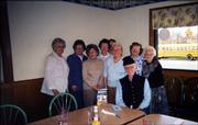Members of the Minervan Literary Club of Lawrence pose with novelist Tom Mach, in front, at their speaker's luncheon March 10 at Perkins Restaurant. From left are Avilla Lee, Ida Jean Bartz, Betty Allen, Betty Brune, Valerie Farley Moreau, Donna Gatts, Elaine Taylor and Virginia Edwards.