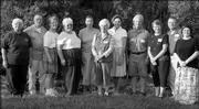 Gardeners, from left, Marie Willis, Jack Landgrebe, Carolyn Landgrebe, Pat Lechtenberg, Margarete Johnson, Thelma Chapman, Joan Craig, Arlis Stebbins, Mary Ann Ring, Stan Ring and Shari Head pose for a picture after the 2005 Douglas County Garden tour, which was organized by the Extension Master Gardeners. Their gardens were on the tour.