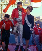 """Driver Curtis Turner, center, celebrates his victory in the 1965 American 500. """"Full Throttle,"""" by Robert Edelstein, explores the life of Turner, who is listed among the top 50 drivers in NASCAR history."""