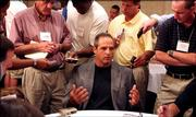 Missouri football coach Gary Pinkel, center, answers questions during the second day of Big 12 Conference football media days. Pinkel appeared Wednesday in Houston.