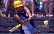 """Lawrence Hummers batter Dacia Sprow leans in to take a swing against the Paola Explosion during a game in the 18-under bracket at the American Fastpitch Assn. """"B"""" National Tournament. The Hummers won, 5-1, Wednesday at Holcom Sports Complex in their first game in the tournament."""