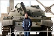 A Chinese man walks in front of a Soviet-made tank on display at the military museum in this Jan. 21 file photo in Beijing. The U.S. government says Chinese military planners are looking to expand power in the Asia-Pacific beyond their immediate goal of dominating rival Taiwan, but China's foreign minister insisted Wednesday that his country is no danger to others. Beijing is modernizing its arsenal with the addition of fighter jets, submarines, missiles and other high-tech weapons - many of them bought from Russia.
