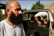 Former Afghan Guatanamo prisoners Moheb Ullah Borekzai, left, and Habir Russol exit a car after being released Wednesday after a detention at Guantanamo Bay in Cuba. They claim about 180 other Afghans held at the U.S. detention facility were on a hunger strike to protest alleged mistreatment. They say they did not participate in the hunger strike.