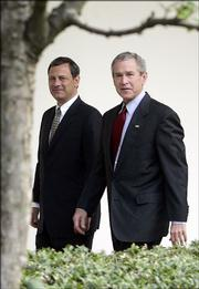 President Bush and his nominee for the Supreme Court, John Roberts, walk together after meeting Wednesday at the White House. Supreme Court nominee John G. Roberts began his confirmation campaign to nail down Republican Senate support and overcome Democrats' fears that he would push the nation's highest court far to the right on abortion and other polarizing issues.