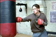 "Maggie Fitzgerald (Hilary Swank) works out in the gym run by boxing trainer Frankie Dunn (Clint Eastwood) in 2004&squot;s ""Million Dollar Baby."" The Oscar-winning film was released on DVD this month."