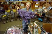 Penn House sorter, Perry Hartman, Lawrence, begins folding clothes Wednesday at the thrift shop at 1035 Pa. Hartman and other employees are expecting a greater influx of donations now that the Salvation Army Thrift Store, formerly at 1818 Mass., has closed.